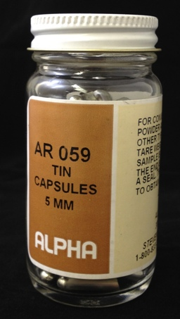 Alpha Resources Africa Product AR059 in Tin Capsules under Sample Containment.