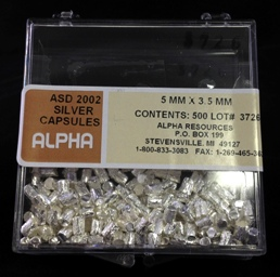 Alpha Resources Africa Product ASD2002 in Silver Capsules under Sample Containment.