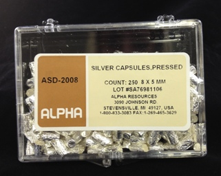 Alpha Resources Africa Product ASD2008 in Silver Capsules under Sample Containment.